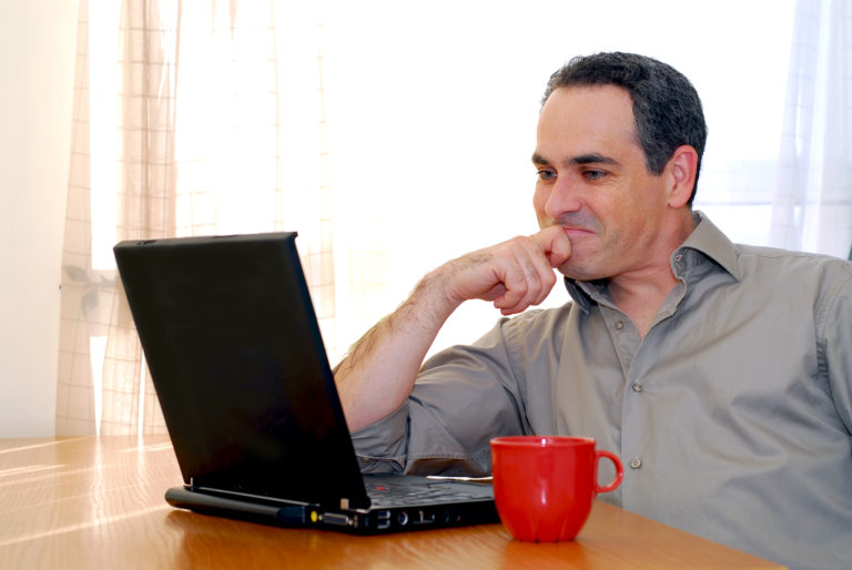 Man With Laptop and Red Cup