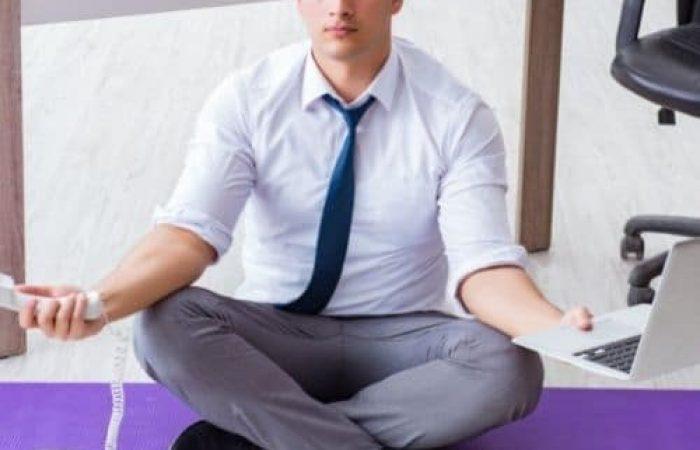 man in suit doing yoga